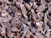 Photo of Choclate Brown Rubber Bark for Playground and Landscaping Ground Cover Applications